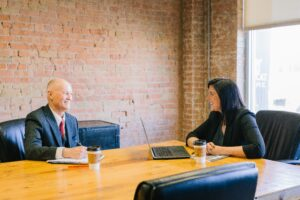 man and women in meeting discussing career progression